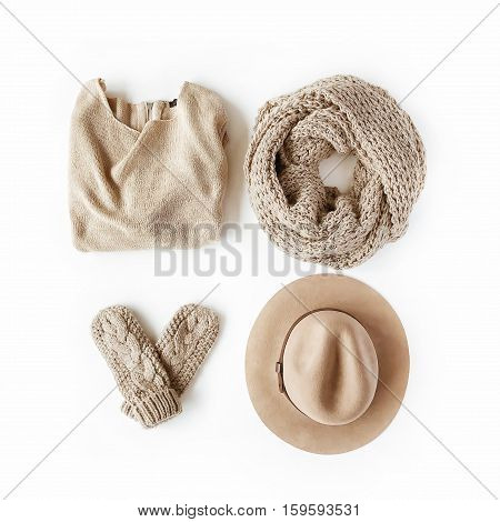 beauty feminine clothes arrangement with hat mittens sweater scarf. flat lay top view