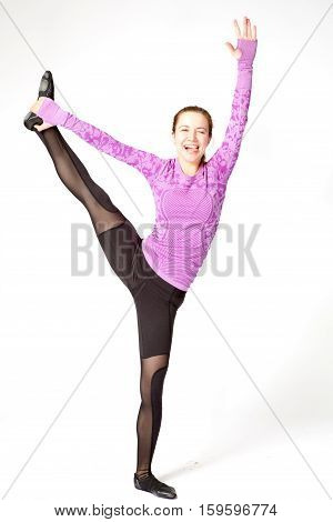 Sports Positive Woman In Sportswear Standing One Leg On The Floor Another Stretched Upwards, With Po