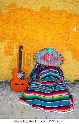 Mexican typical lazy man sombrero hat guitar serape nap siesta