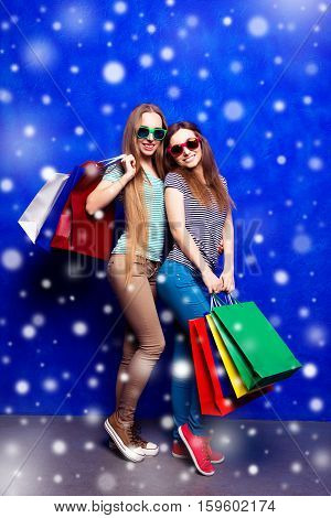 Happy Sisters With Shopping Bags Buying Presents On Christmas