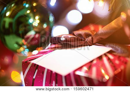 new year present box close up on blurred lights background