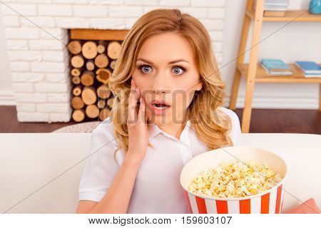 Shocked Young Woman Watching Horror Film With Popcorn
