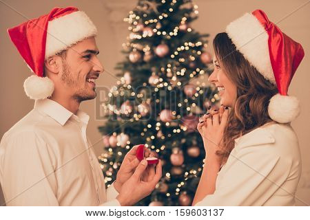 Young Happy Man Making Proposal Of Marriage His Excited On X-mas Evening While Standing In Profile