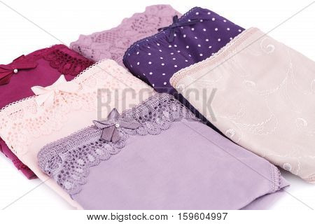 Six colorful panties on white background, close up picture.