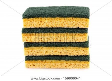 Stack of sponges isolated on white background.
