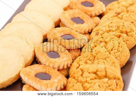 Sweet cookies on brown plate close up picture.