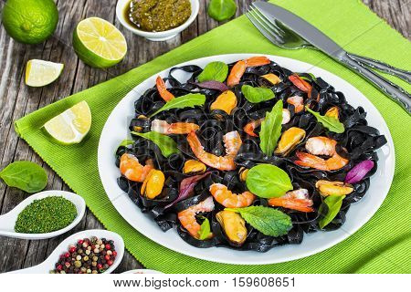 Black Noodles Salad With Prawns, Mussels, Fresh Green Leaves