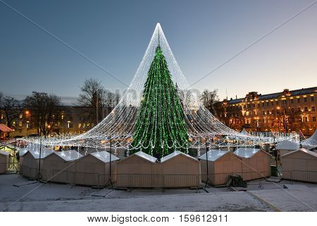 VILNIUS LITHUANIA - NOVEMBER 28: Night view of the christmas tree in Vilnius on November 28 2016 in Vilnius Lithuania. In 1994 the Vilnius Old Town was included in the UNESCO World Heritage List.