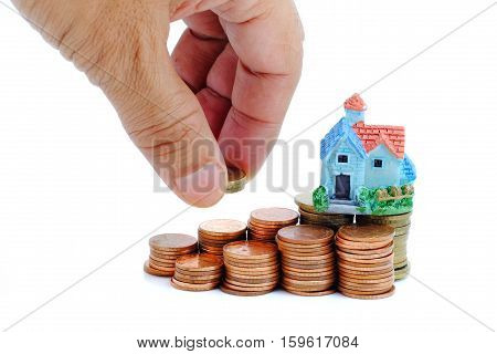 Collect coins for buy a house concept.