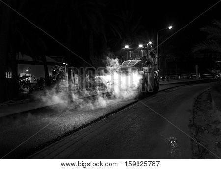 steamroller working during night repairing the road.