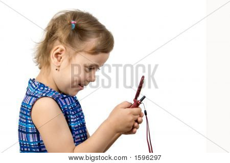 Fun Little Girl Playing On A Mobile Phone