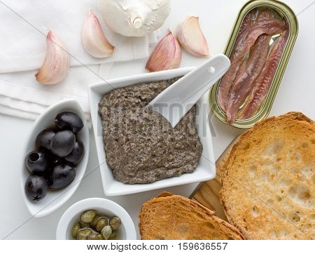 Tapenade traditional Provence sauce with black olives capers garlic and anchovies.