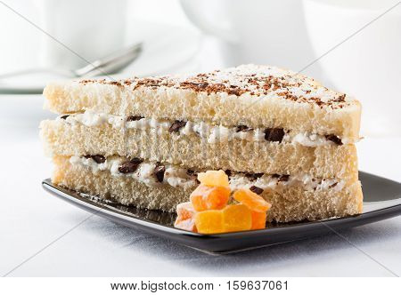 A sweet layered sandwich with ricotta cheese and chocolate chunks