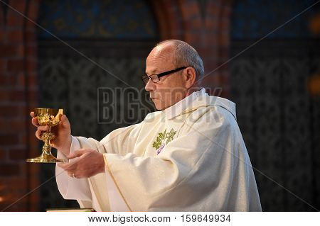 Catholic Priest With Chalice Cup