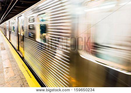 Blur of New York City subway train leaving station