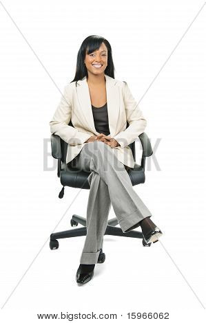 Black Businesswoman Sitting In Office Chair