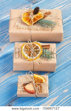 Wrapped Gifts With Decoration For Christmas Or Other Celebration On Boards
