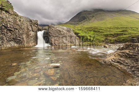 Waterfall in the Fairy Pools rocky stream on Isle of Skye