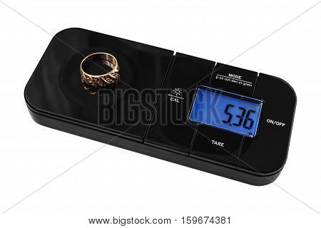 Digital Jewelry scales with golden ring on white background