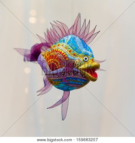Fish, ornamental decoration. It is painted in bright colors. Exhibition of toys, Kiev, Ukraine. 2011-05-19 17:45:48