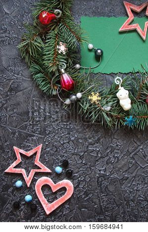 Christmas decorations on a dark background with Christmas toys