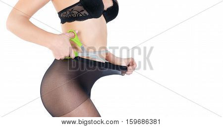 Woman with scissors cuts the stockings tights because too tight