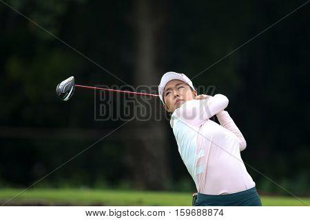 KUALA LUMPUR, MALAYSIA - OCTOBER 29, 2016: Jenny Shin of South Korea tees off at the TPC Golf Course at the 2016 Sime Darby LPGA Malaysia golf tournament.
