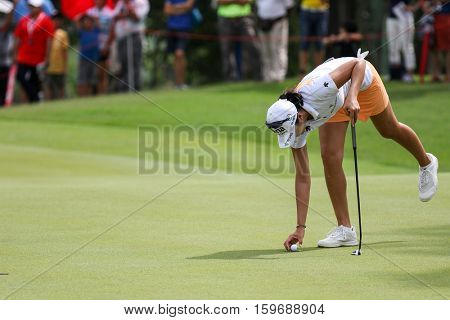 KUALA LUMPUR, MALAYSIA - OCTOBER 29, 2016: Mi Jung Hur of South Korea prepares her putt at the green of the TPC Golf Course at the 2016 Sime Darby LPGA Malaysia golf tournament.