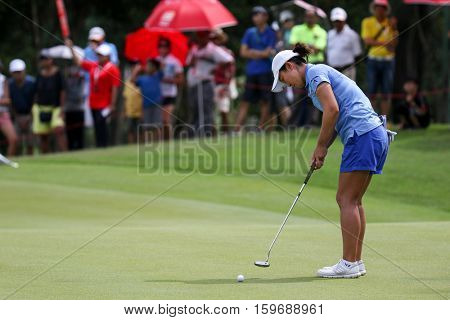 KUALA LUMPUR, MALAYSIA - OCTOBER 29, 2016: Candie King of Chinese Taipei putts at the green of the TPC Golf Course at the 2016 Sime Darby LPGA Malaysia golf tournament.