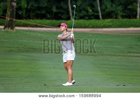KUALA LUMPUR, MALAYSIA - OCTOBER 29, 2016: Lydia Ko of New Zealand plays from the fairway of the TPC Golf Course on Round 3 of the 2016 Sime Darby LPGA Malaysia golf tournament.