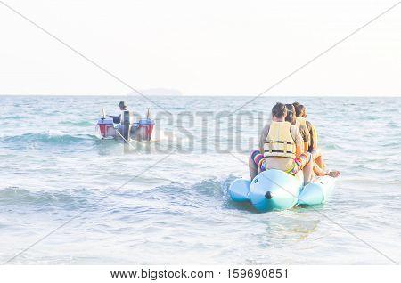 people's riding a banana boat , banana boat