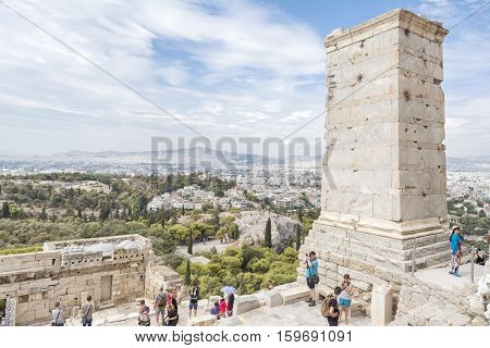 ATHENS, GREECE, SEPTEMBER 6, 2016: Monument to Agrippa at the entrance of Acropolis, an ancient citadel located on an extremely rocky outcrop above the city of Athens.