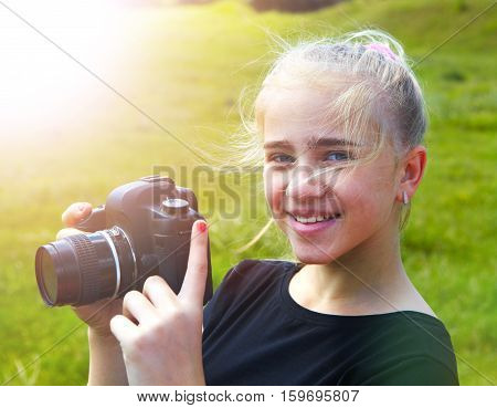 Young photographer and reflex camera. Children photographing in the morning
