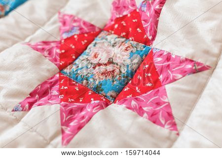 Patchwork quilt. Part of patchwork quilt as background. Flower print. Color blanket in style patchwork. Color blanket. Handmade.
