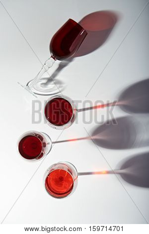 shadows from wine glasses on white background view from top