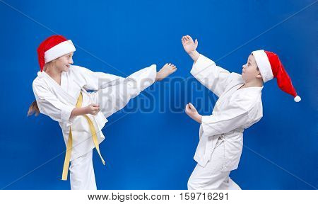 Boy and girl are trained sparring karate