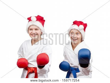 Children sportsmen are in the rack karate with the overlays on the hands