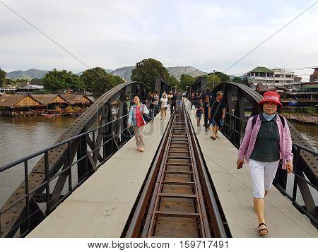 KANCHANABURI THAILAND - NOVEMBER 26: unidentified asian people walking on Bridge on the river Kwai on November 26 2016 in Kanchanaburi Thailand