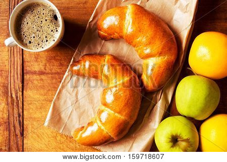 Dessert with freshly baked croissants, coffee and fruit