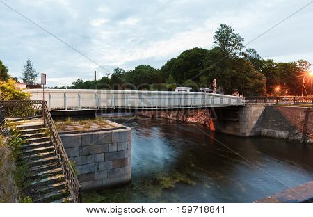 The dock bridge or Dokovy bridge over the canal of Peter the Great in Kronstadt St. Petersburg at white night at summer.