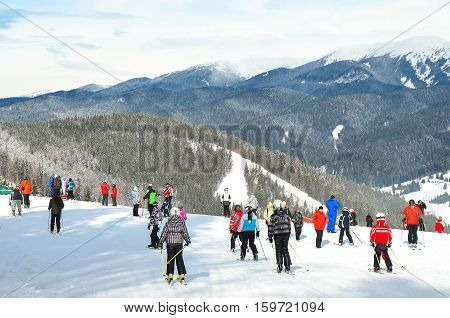People in the ski resort in the mountains
