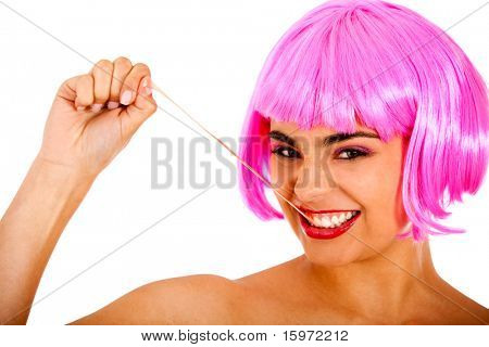 Eccentric woman wearing a pink wig and playing with bubble gum -  isolated