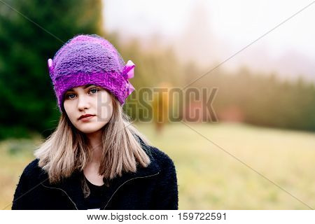 Thoughtful Young Woman In Woolen Violet Blue Cap