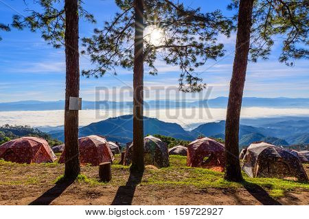 View of morning mist and sun rise at Doi Ang Khang mountain one of the famous mountains in Chiangmai place for camping with tent on winter Chiang Mai Thailand.