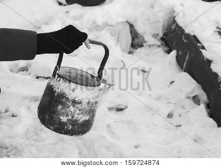 old kettle in the hands of the poor