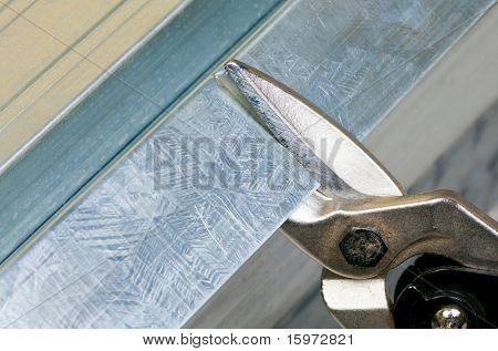 Cutting steel stud with tin snip cutter
