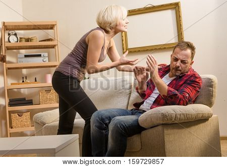 Couple man and woman having conflict, battle and fight at home. Couple in love screaming, shouting at home atmosphere. Quarrel concept.