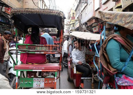 DELHI, INDIA - FEBRUARY 13 : Crowded Indian side street in Old Delhi, India on February 13, 2016.