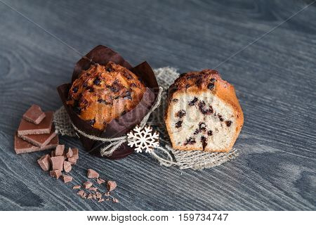 muffin with slices of chocolate on a wooden table