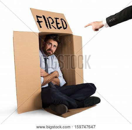 Desperate and fired businessman hides in the cardboard